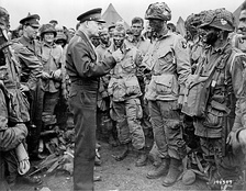General Eisenhower addresses soldiers preparing for D-Day assault.  According to Gray's biographers, he is the soldier in visored cap (not helmet) at far left.