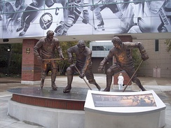 A statue of the French Connection line stands outside KeyBank Center. Consisting of Gilbert Perreault, Rick Martin, and Rene Robert, they played together from 1972 to 1979.