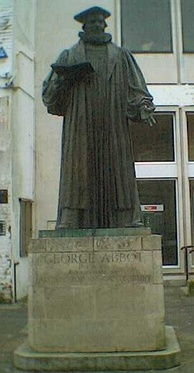 The statue of Archbishop George Abbot stands at the top of Guildford High Street