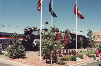 "GN's 4-8-4 S-2 ""Northern"" class locomotive #2584 and nearby sculpture, U.S.–Canada Friendship in Havre, Montana"