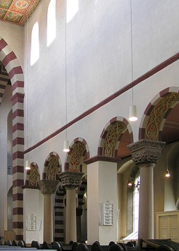 St Michael's, Hildesheim, shows two columns set between the piers.