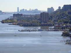 Southward view of the Hudson Waterfront from the George Washington Bridge, with Edgewater in the foreground, and the skyline of Downtown Jersey City, Hudson County in the background.