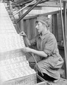 A female worker changing jacquard cards in a lace machine in a Nottingham factory (1918 (First World War).