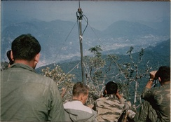 U.S. soldiers directing artillery on enemy trucks in A Shau Valley, April 1968