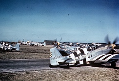 "P-51 Mustangs, including (E9-S, serial number 42-106707) nicknamed ""Sleepytime Gal"", (B7-E, serial number 42-106839) nicknamed ""Bald Eagle III"" and (E9-K) nicknamed ""Vi"" opf the 361st Fighter Group line up for take off on D-Day at Bottisham."