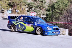 Stéphane Sarrazin driving a Subaru Impreza WRC2005 on the 2005 rally.