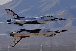 Two F-16s demonstrate a Reflection Pass