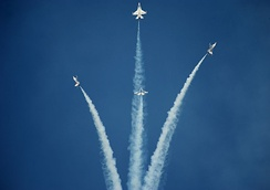The Thunderbirds performing their signature bomb burst maneuver.