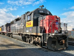A former Southern Pacific GP38-2 locomotive with an intact L-shaped engineer's windshield.