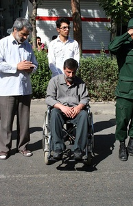An Iranian veteran and war wounded man of Iran–Iraq War on wheelchair in Nishapur, funeral of his comrade