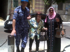 Soldier helps an elderly woman to reach the polling station in Alexandria – 27 May 2014