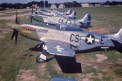 370th Fighter Squadron North American P-51Ds parked on the line in 1944.