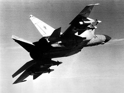 An air-to-air right underside rear view of a Soviet MiG-25 Foxbat aircraft carrying four AA-6 Acrid missiles