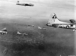 B-17s of the 92d Bomb Group on a mission over Nazi Occupied Europe. Visible is Lockheed/Vega B-17G-70-VE Flying Fortress Serial 44-8579