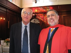 A South African PhD graduate (on right, wearing ceremonial gown)