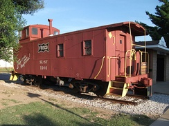 Frisco caboose at Centennial Park, Rogers Historical District downtown. The caboose is emblematic of Rogers' railroad history.