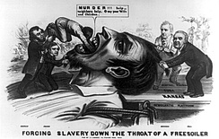 "Forcing Slavery Down the Throat of a Freesoiler – An 1856 cartoon depicts a giant ""Free Soiler"" being held down by James Buchanan and Lewis Cass standing on the Democratic platform marked ""Kansas"", ""Cuba"" and ""Central America"". Franklin Pierce also holds down the giant's beard as Douglas shoves a black man down his throat. A victim of lynching can also be seen in the background."