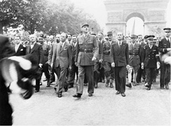General de Gaulle and his entourage stroll down the Champs Élysées following the liberation of Paris in August 1944