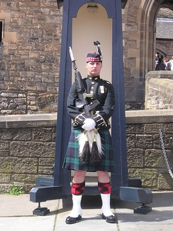 A sentry of the Royal Regiment of Scotland posted on the Esplanade outside Edinburgh Castle
