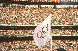 The Olympic flag waves at the 1996 games.