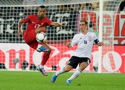 Full-back Philipp Lahm (right) marks winger Nani.