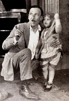 Tod Browning with unidentified child on set of No Woman Knows (1921)