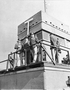 USAAF Personnel waiting for the return of 4th Fighter Group aircraft on the Debden Control Tower, 25 September 1943
