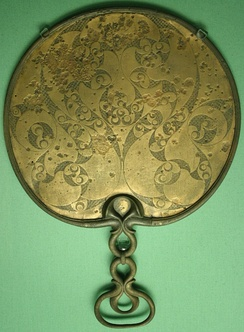 A 1st century BCE mirror found in Desborough, England, showing the spiral and trumpet motif