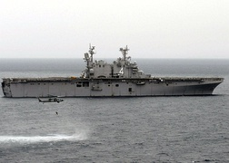 USS Nassau (LHA-4), a Tarawa-class amphibious assault ship and the first of this type to operate as an aircraft carrier
