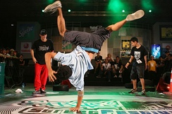 Breaking, an early form of hip hop dance, often involves dance battles, showing off technical skills, trying to out-do a rival dancer, and displaying tongue-in-cheek bravado.