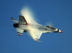 A Thunderbird solo aircraft flies by at nearly the speed of sound (700 mph).