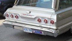 "A car displaying an ""Obama '08"" bumper sticker alongside its license plate"