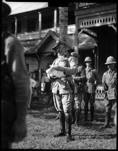 Colonel Robert Logan reading a proclamation in Apia, Samoa, on 30 August 1914, the day he assumed responsibility as military administrator.