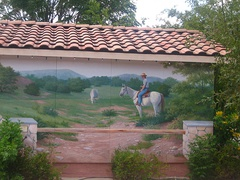"Outdoor mural reflects the theme of Bandera as the ""Cowboy Capital of the World"""