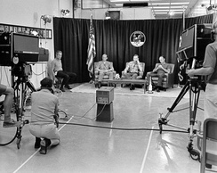 Deke Slayton (on stool at left) and the Apollo 11 crew during the last pre-flight press conference