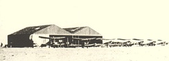 Ismailia Aerodrome with BE 2C two seater aircraft outside the hangars