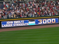An electronic banner announcing the milestone achievement of John Smoltz recording his 3000th strikeout during a game in April 2008