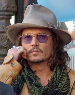 Depp at Penélope Cruz's ceremony to receive a star on the Hollywood Walk of Fame in April 2011