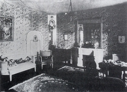 Le Salon Bourgeois, designed by André Mare inside La Maison Cubiste, in the decorative arts section of the Salon d'Automne, 1912, Paris. Metzinger's Femme à l'Éventail on the left wall