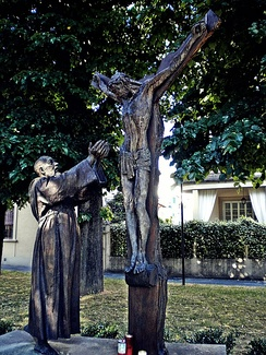 Sculpture of Padre Pio with Jesus on the cross in Prato, Italy