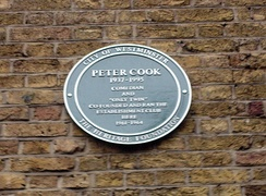 Cook's green plaque marking the site of the Establishment Club in Greek Street, Soho, London