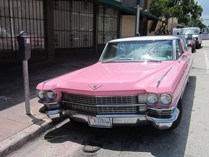Pink is sometimes associated with extravagance and a wish to be noticed. A 1963 pink Cadillac.