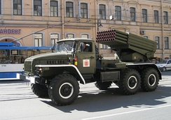 "BM-21 launch vehicle (Russian: БМ-21 ""Град""), (Grad) a Soviet truck-mounted 122 mm multiple rocket launcher."