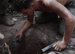 "A US ""tunnel rat"" soldier prepares to enter a Viet Cong tunnel."