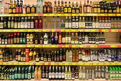 A display of various liquors in a supermarket