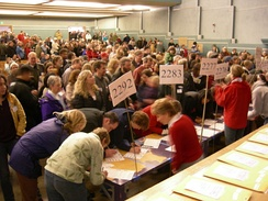 Voters checking in at a 2008 Washington State Democratic caucus held at the Nathan Eckstein Middle School in Seattle