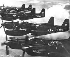 Flight of 339th FS F-82Gs (46-403, 46–390, 46–366, 46–394) heading to Korea in June 1950.