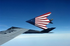 A pair of specially painted F-117 Nighthawks sporting a United States flag theme on their bellies fly off from their last refueling by the Ohio Air National Guard's 121st Air Refueling Wing.