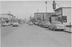Fourth Avenue in 1953, looking east from near I Street. Just ten years before, the retail area shown in the foreground was mostly an industrial area, housing lumber yards and similar uses.