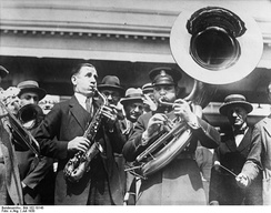 Saxophone and sousaphone players at a charity festival in Chicago, July 1930